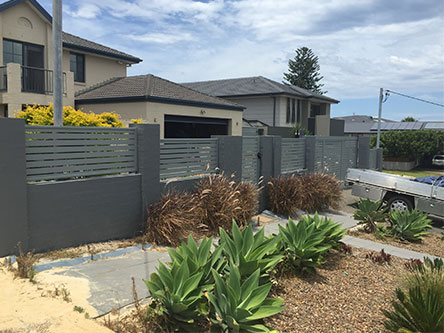 House with grey slatting fence - Fencing Contractors Newcastle, NSW